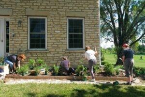 volunteers planting garden picture